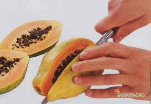 Cut 2 papayas (total weight about 500 g/1lb) lengthwise in half