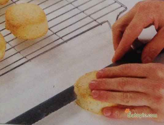 Cut each of the cooled shortcakes in half horizontally with the serrated knife