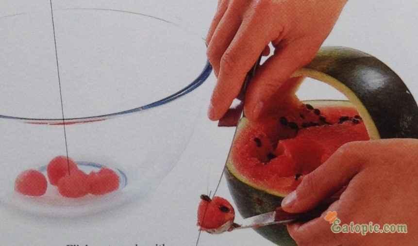 Using the melon bailer, cut balls from the watermelon flesh