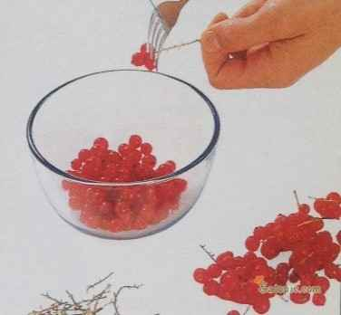 Pick over the redcurrants and pull them from the stalks with the tines of the fork