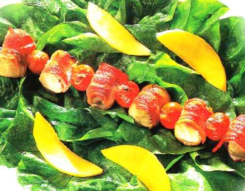 Place a grilled tuna and bacon kebab across the centre of the spinach leaves on each plate