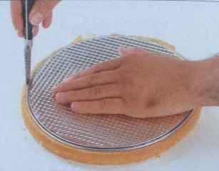 Trim the cake rounds to fit the Springform tin, using the base of the tin as a guide.