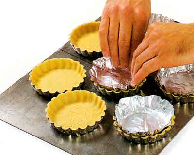Foil ensures that tartlet shell keeps its shape during baking
